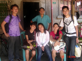Sir Jeff  (left) pose together with deaf group outside Lorenzo's living room (middle standing)