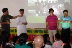 Me (left) reverse interprets for the Deaf signer Rev. Seung Ho Kang.