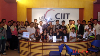 Attendees of 3rd mini-conference pose in front of CIIT board.