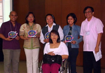 Awardees pose together with NCDA Director Geraldine Ruiz