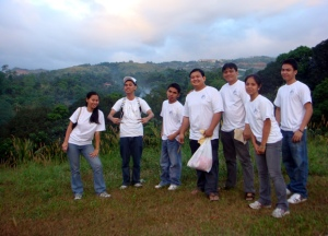 MCCID Santa Claus Team pose on top of future school site (From Left) Joanna Teves, Mark Angelo Reyes, Ariel Quibol, Sir Ervin, Sir Jojo, Jepa Kerena Basilio and Moises Libot