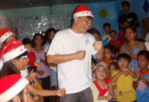 I teach the sign for happy new year to indigent kids of San Mateo, Rizal