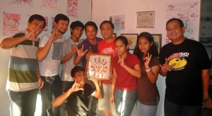 Sir Eric Tansingco (middle) of Take One Animation Studio receives a token Sign Language Wall Clock from MCCID.