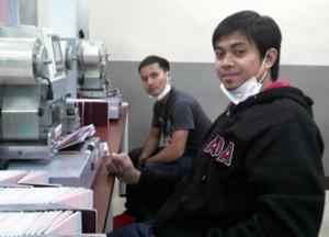 Nonito with Renato also of MCCID, at work in DFA Processing Division.